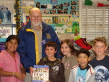 Stephen Olson presents free dictionaries to third graders including his grandson Kolby at Jack London School.