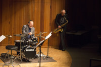 During an intense percusion solo by Akira Tana, Bennett Friedman feels the beat in the jazz quartet's performance.