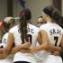 The Bear Cubs volleyball team huddles before a preseason match.