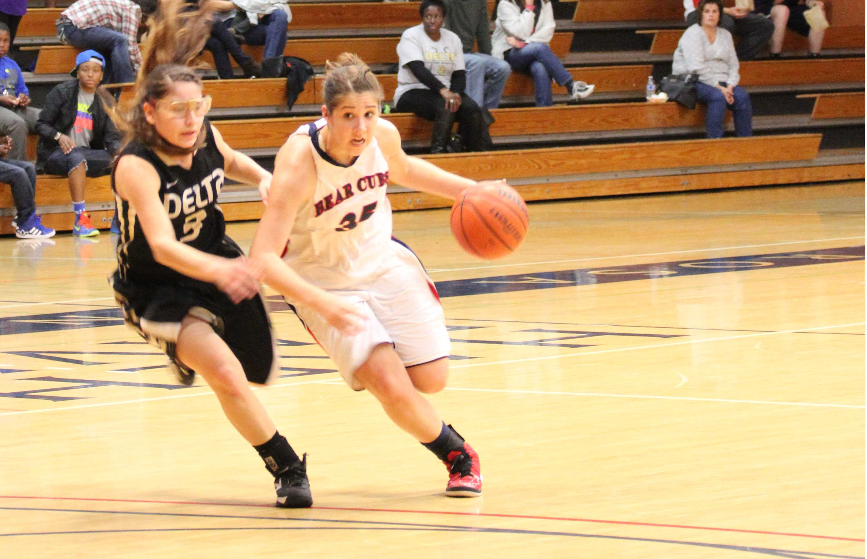 Sophomore guard Whitney Edens drives to the basket against Delta College.