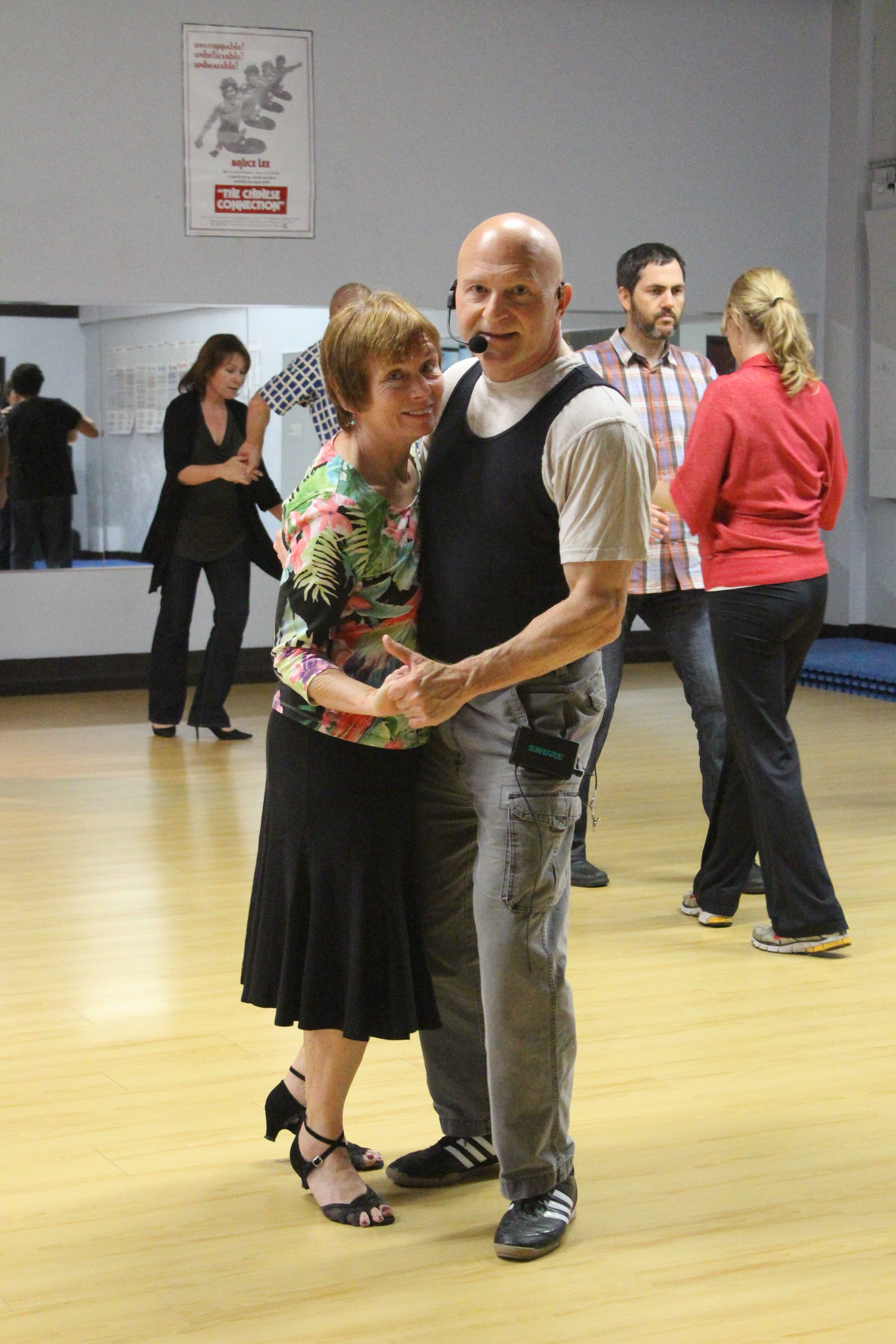 Instructors Annie and Denny lead their students during a swing dance class.