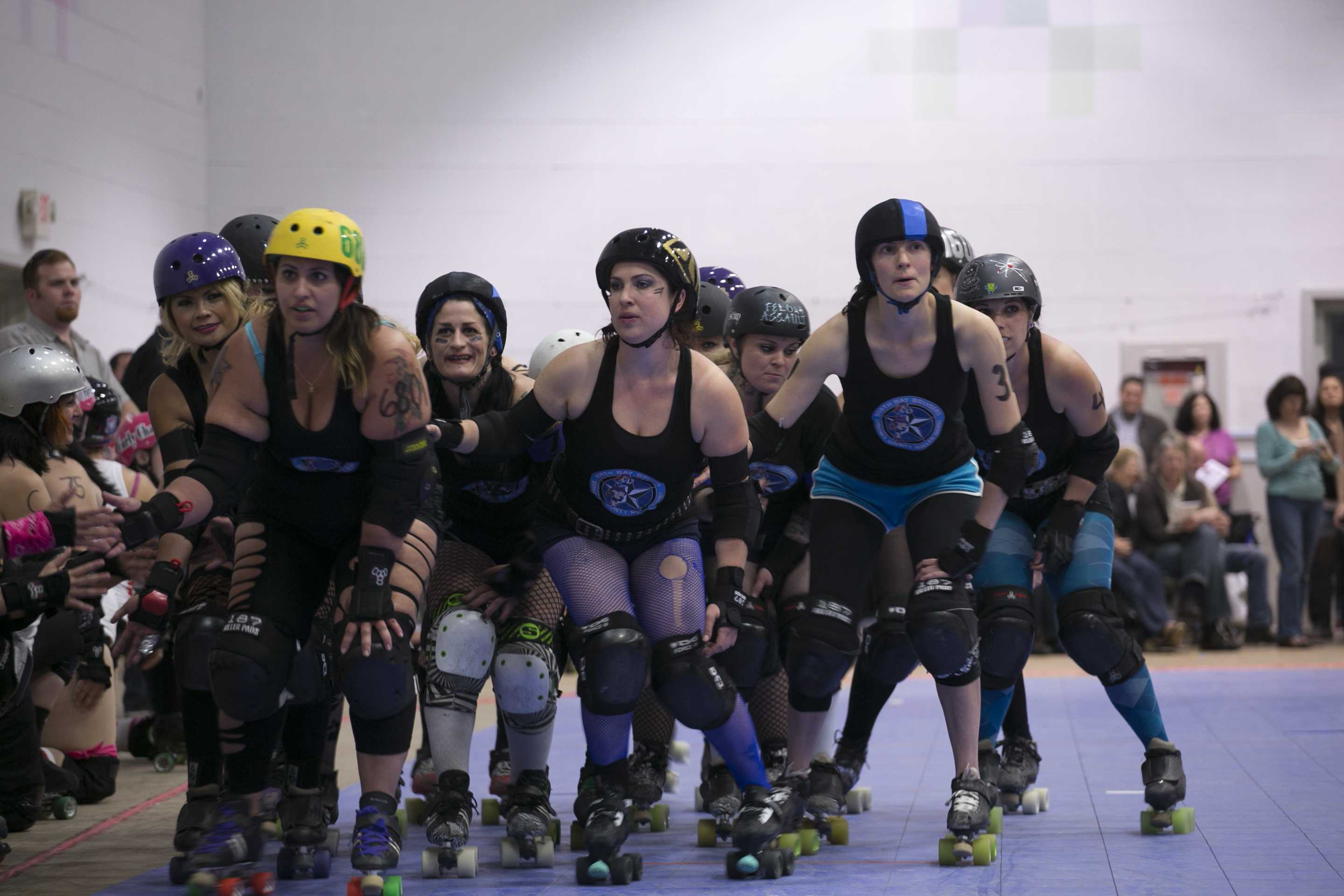 Sonoma County Roller Derby skates as a massive wall around the track in a display of camaraderie and exhibition of strength while individual skaters are introduced over the P.A. Saturday night at the Santa Rosa Veteran's Building.
