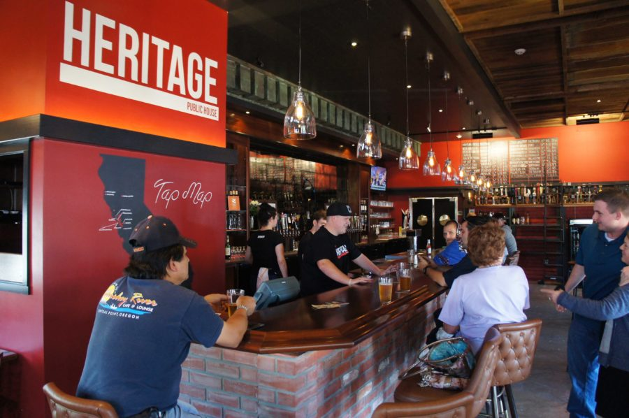 Craft+beer+enthusiasts+crowd+the+bar+as+Heritage+staff+take+orders+from+the+24+rotating+California+breweries+on+tap%2C+mapped+on+the+wall+at+left.