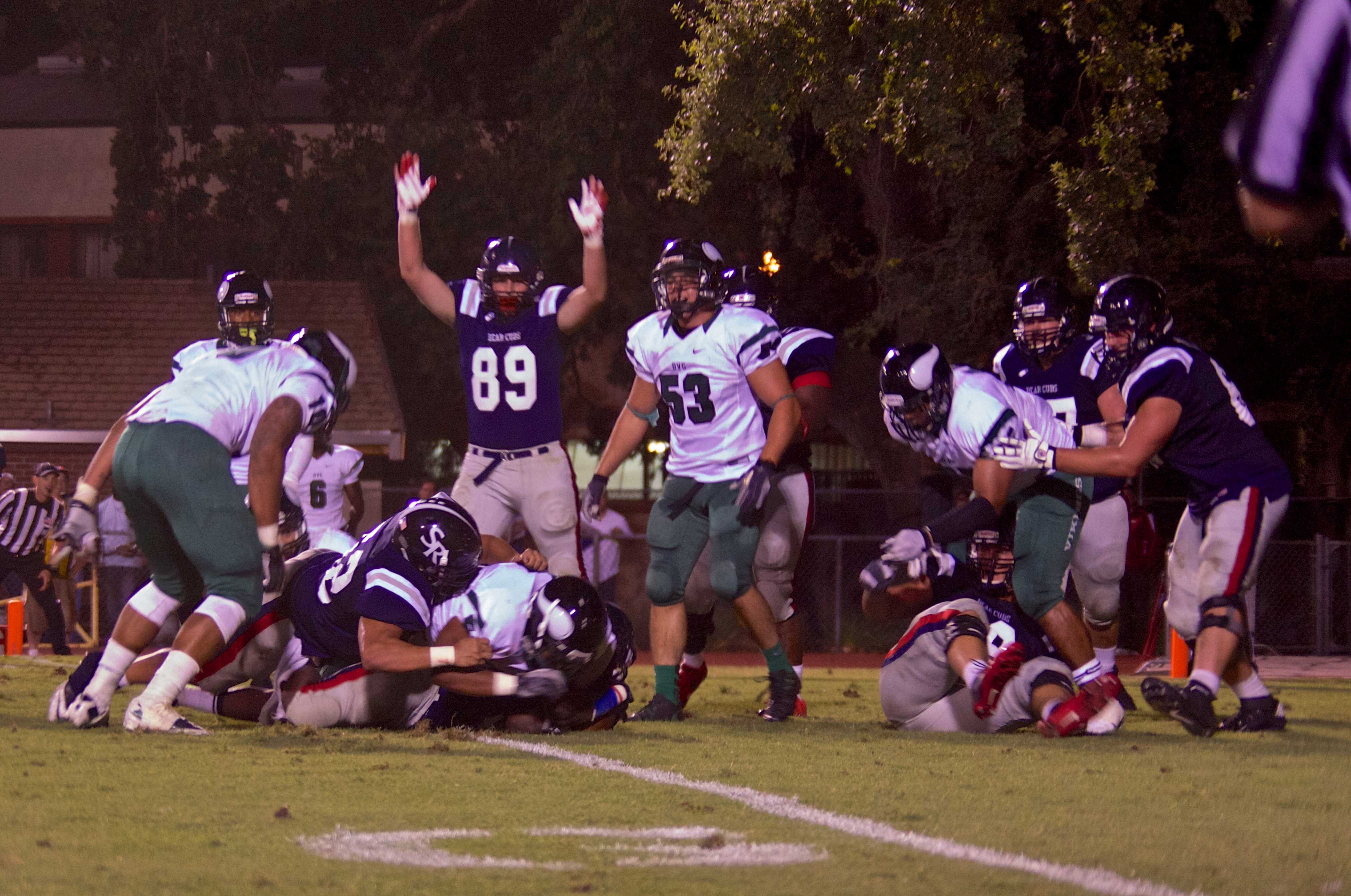 Arms raised by SRJC tight end Nick Reynolds as Bear Cubs' running back K'Lan Anderson rushes for a 1-yard touchdown against Diablo Valley College Sept. 13 in Santa Rosa.