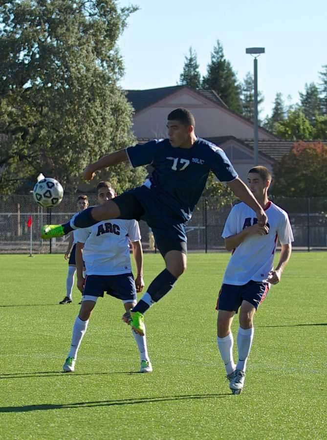 Freshman forward Omar Nuno leaps in into the air to take the ball away from American River College Sept. 27 in Santa Rosa.