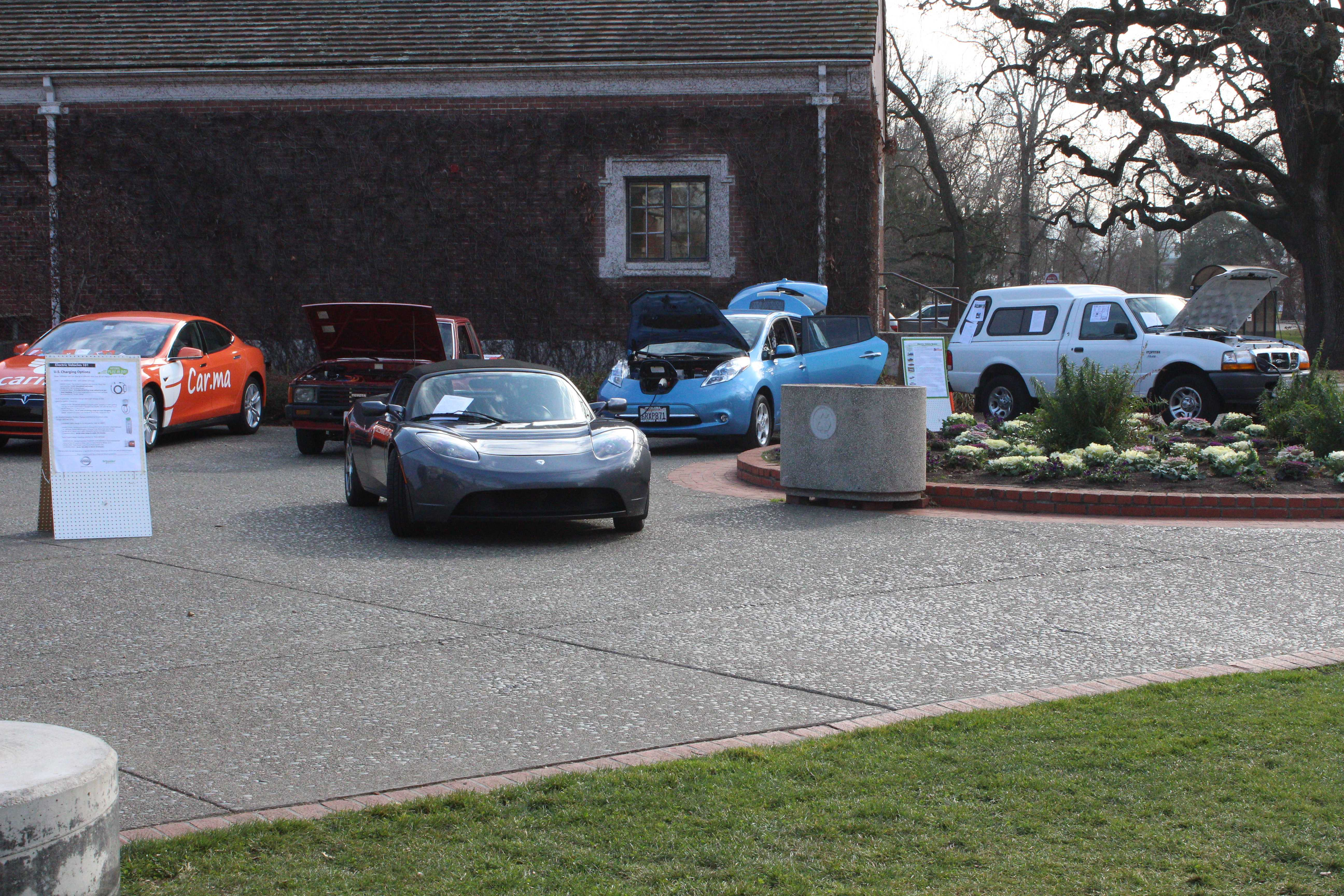 An electric car show (above) gives attendees a real life application of how renewable strategies are underway in the car industry.