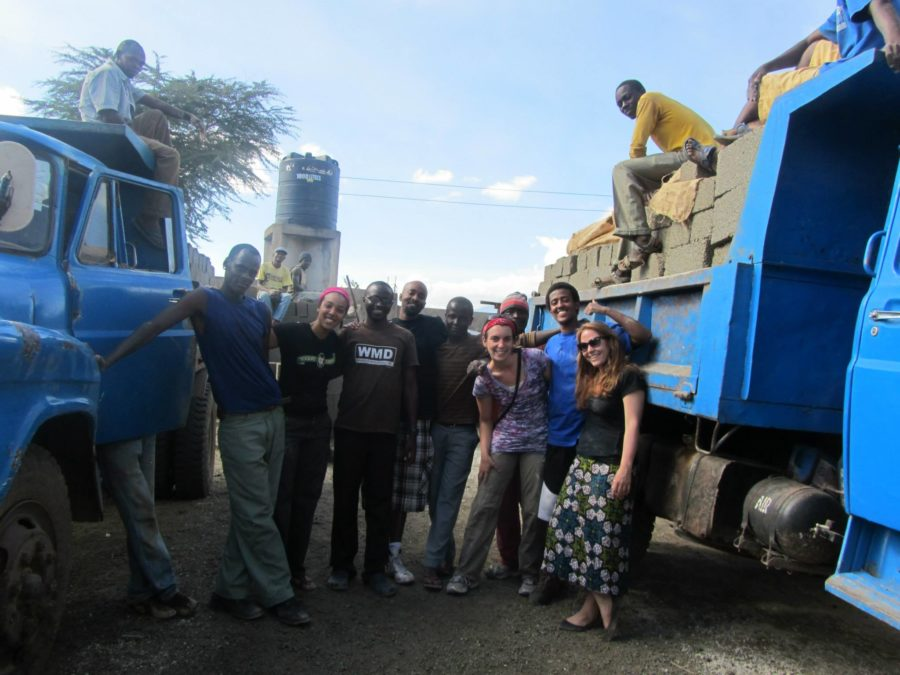 Santa Rosa Junior College Black Student Union members pose with local construction workers in Arusha City, Tanzania.