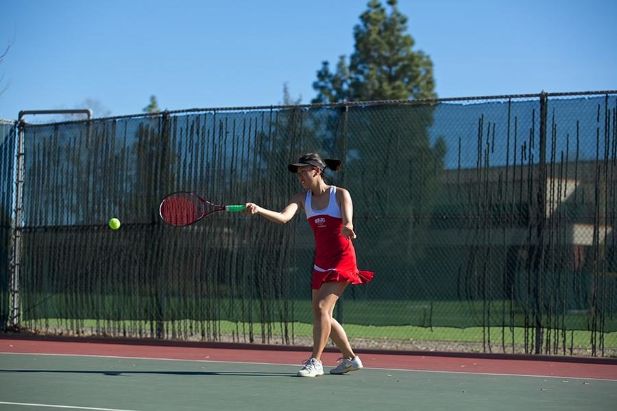 Angel Tran returns service against Folsom Lake Feb. 21 at SRJCs home tennis court.