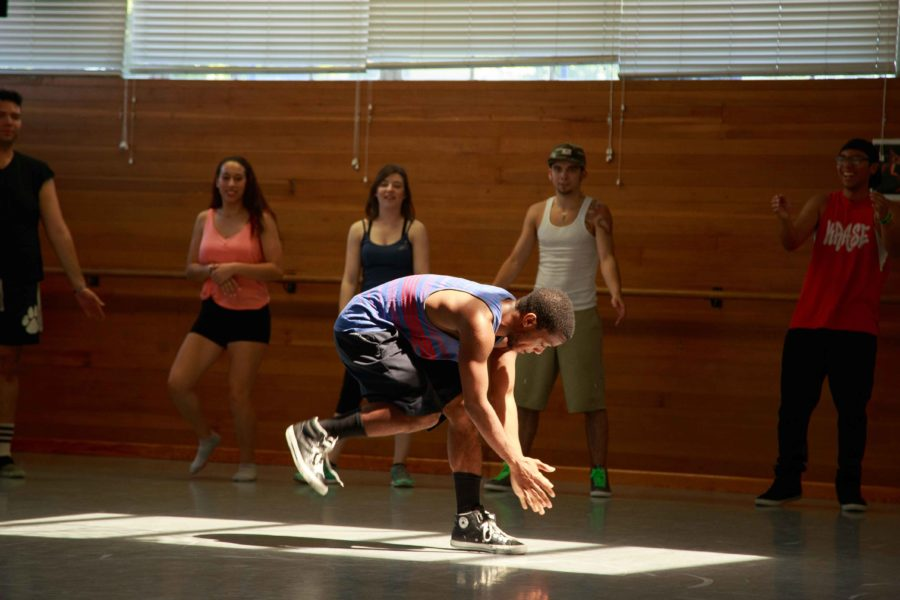James+Dory+practices+his+dance+in+the+middle+of+a+circle+of+his+peers.+Dory+and+his+fellow+students+will+perform+May+9-11+at+8+p.m.+in+Burbank+hall.