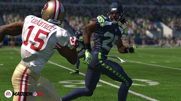 """Roger Sherman from the Seattle Seahawks tries to intercept the ball from San Francisco 49ers offense player Michael Crabtree in this years """"Madden 15."""