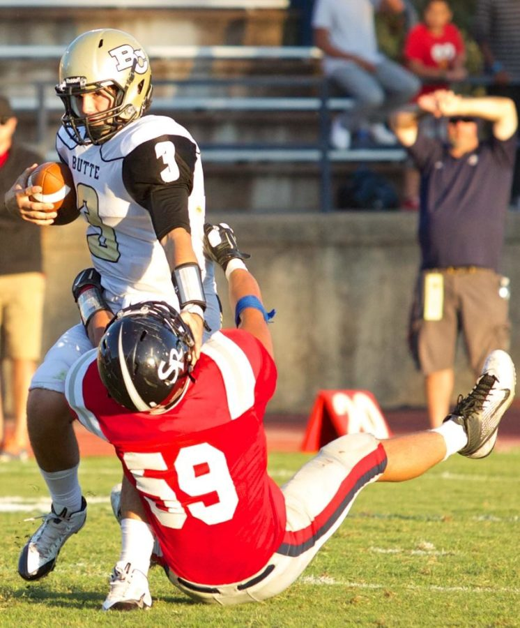 Bear Cubs John Amandoli pulls Butte College's QB Zach Kline to the ground for a sack Sept. 13 at Bailey Field Santa Rosa.