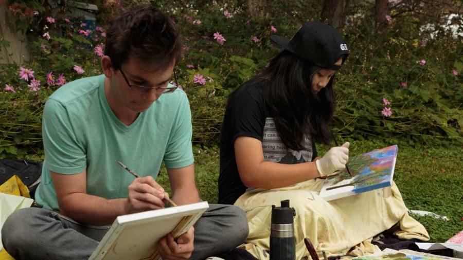 Deborah Kirklins Art 14 beginning painting students Dylan Stefanisko, 21 (left) and Y Pham, 19 (right) working en plein air this fall on the SRJC campus. (Jeanine Flaton-Buckley/Oak Leaf)