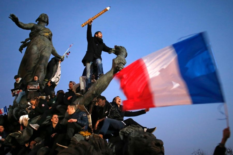 Supporters of free speech gather on the Marianne statue in Paris, France.