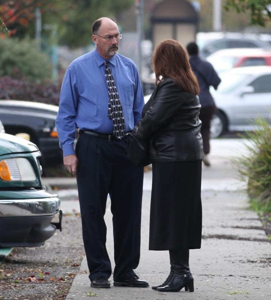 Jeffrey and Karen Holzworth standing outside the court, discussing the trial on Dec. 2012
