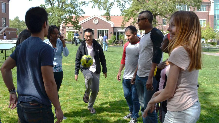 SRJC student Huy Pham participates in an informal soccer practice with friends, all members of the International Club