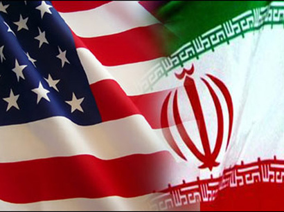 American  and Iranian flags contrast much like the nations they represent.