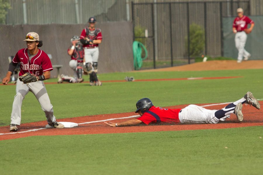 Jake Scheiner steals third base on a passed ball against Sierra College April 24 at Sypher Field.