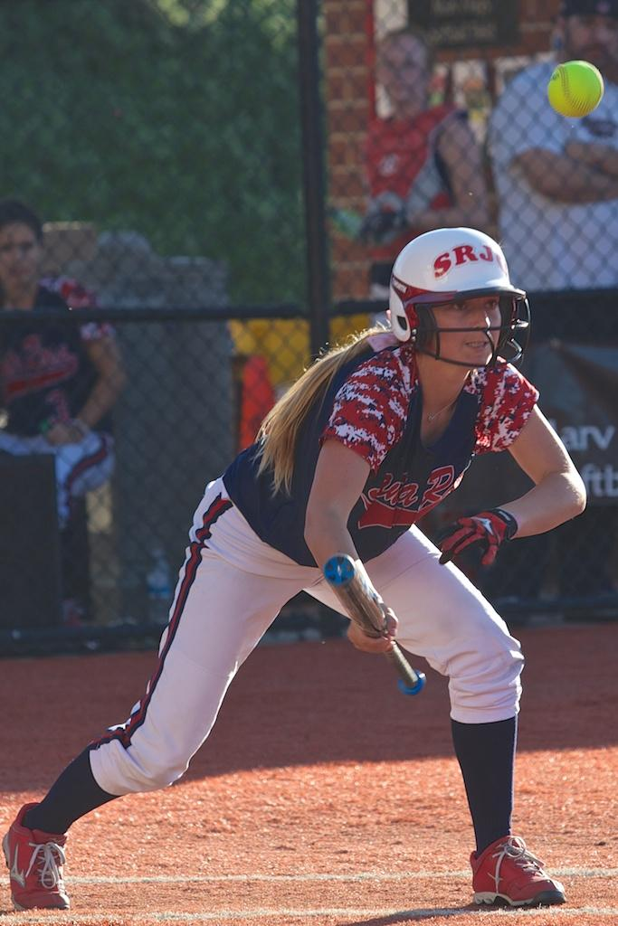 Becca Stenier lays down a bunt to get on first base against Butte College Feb. 21 at Marv Mays Field.