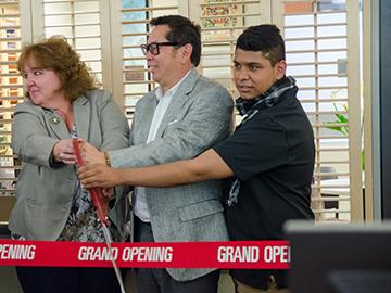 SRJC President Dr. Frank Chong and supporters of the Dream Center cut the ribbon at the grand opening.