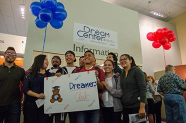 Jordan Panana Carbajal stands with fellow DREAMers during the opening event of the Dream Center.