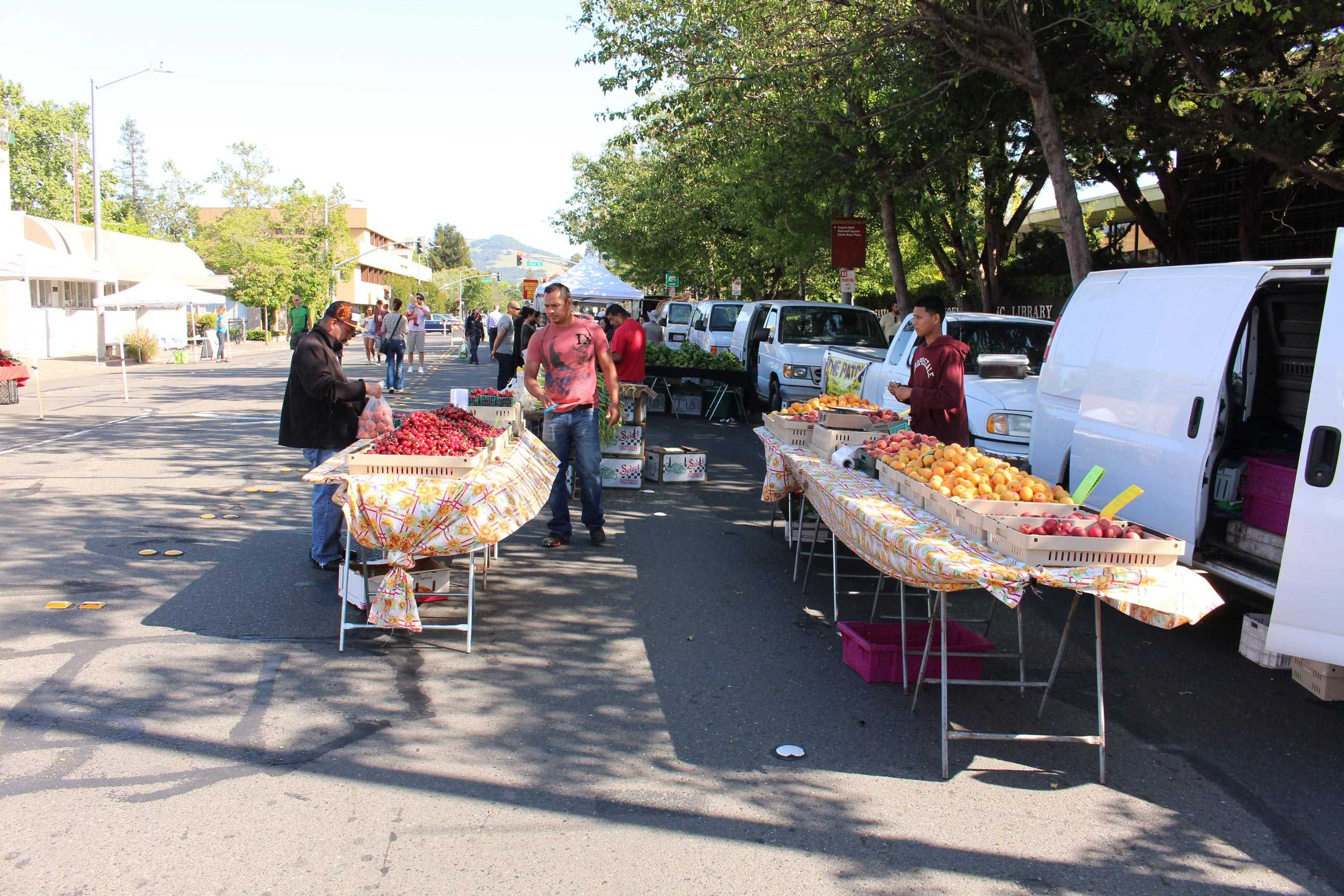 Farmers set up for the first Wednesday Night Market of the year, where students can  buy fresh produce, local honey and hand-crafted treats on Fourth Street.
