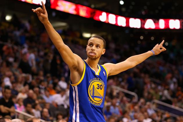 Stephen Curry raises his hands during a game. Curry was announced league MVP . This is Curry's first MVP award.