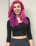 Devan Deleon sports hot pink hair that accentuates her bubbly personality.