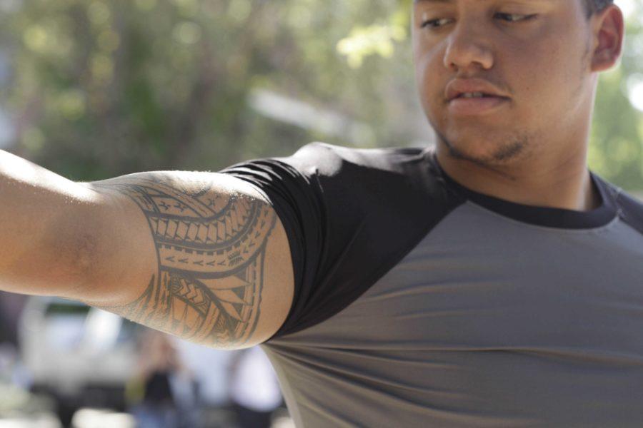 SRJC communications major Carlos Soto displays his tribal tatoo