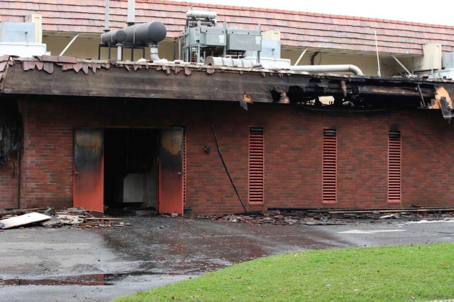 A building that housed electrical equipment remains in ruins after a fire gutted the interior.
