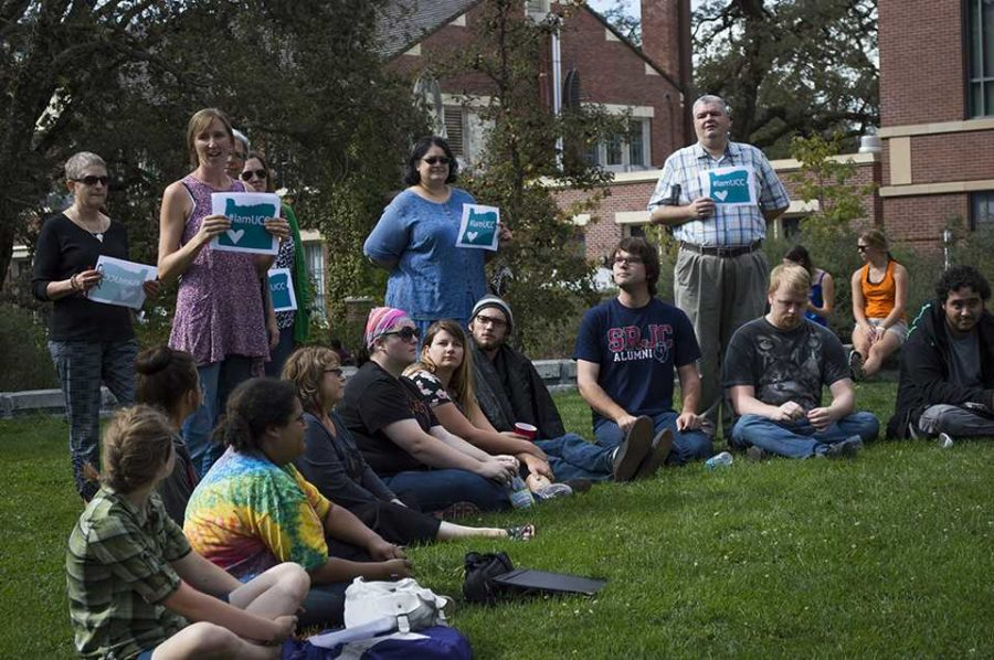 Students sit for the Love-In and SRJC librarians stand with #IamUCC signs.