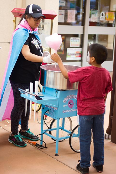 Attendees choose from a variety of carnival-themed food, such as cotton candy and other sweets.