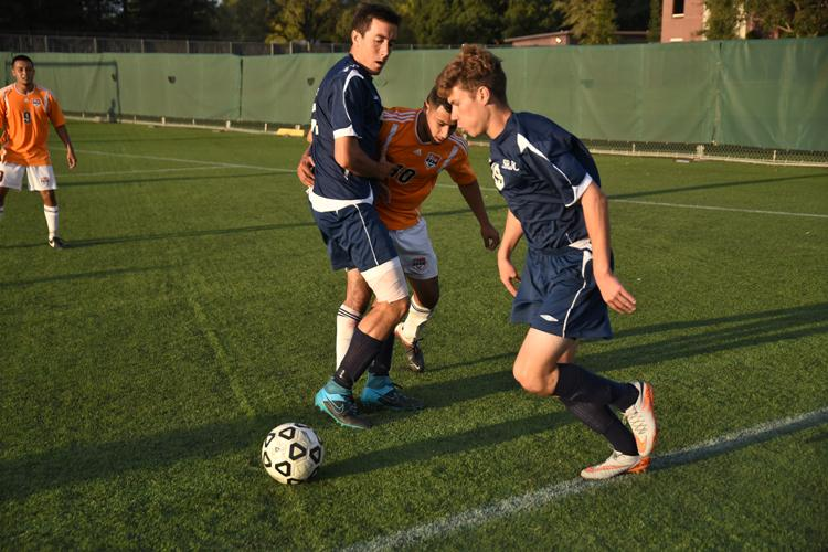 Bear Cubs midfielder Nathan Bell takes the ball to the goal against Consumnes River College