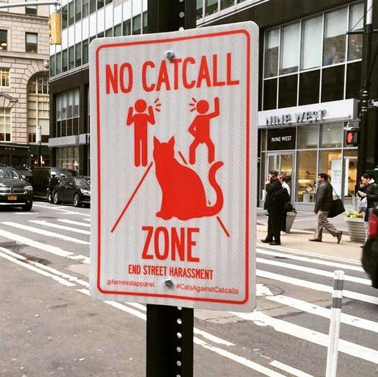 """""""No catcall zone"""" signs appear in the streets of New York City."""