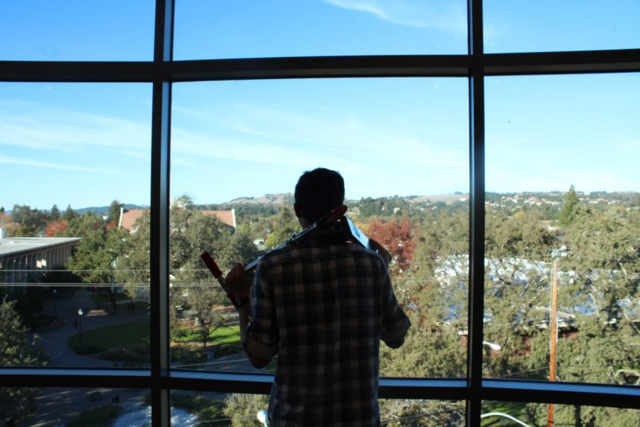 """Adam Gockel coasts around SRJC campus by scooter. """"It gets me places a lot faster than walking; cuts down [travel] time by over a half,"""" he said."""