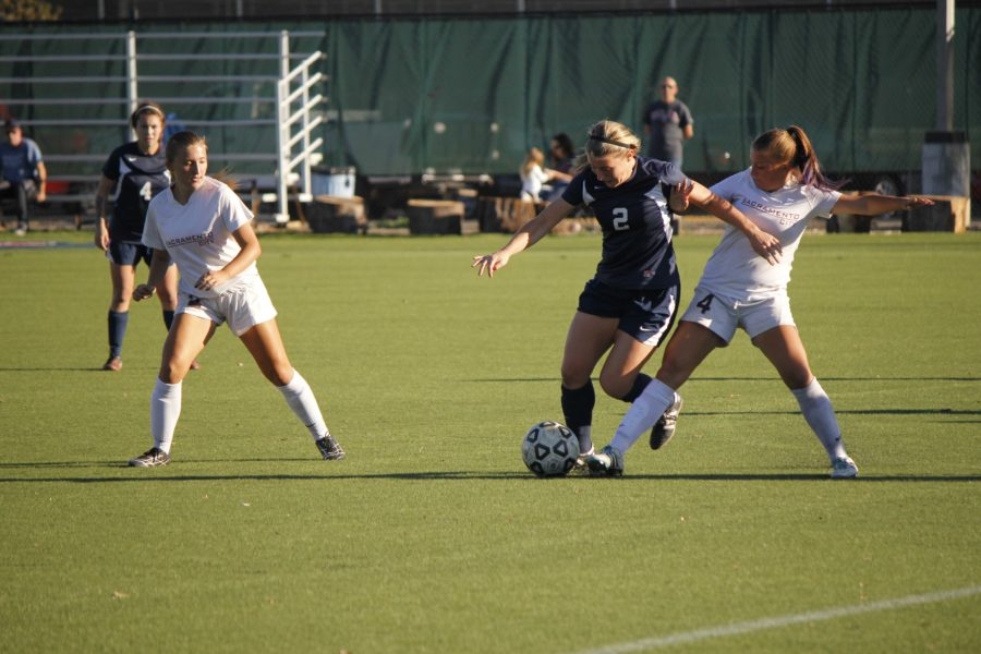 Bear Cubs defender Megan Flynn fights for possession of the ball against San Joaquin Delta College. Flynn is part of a dominant defensive unit that allowed just nine goals over the entire regular season.