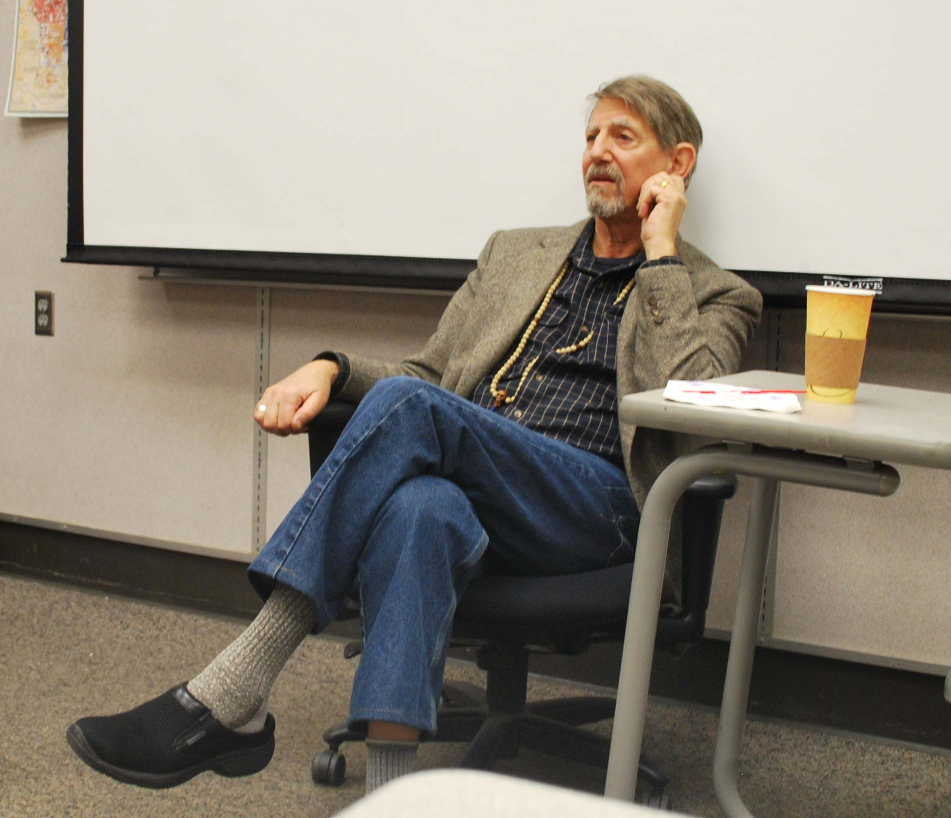 Peter Coyote speaks to students.
