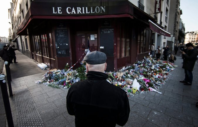 Passers-by pause at one of the sites of the Paris attacks. Many of the terrorists involved in the explosions were French nationals, perhaps reacting to anti-Arab sentiment in France.