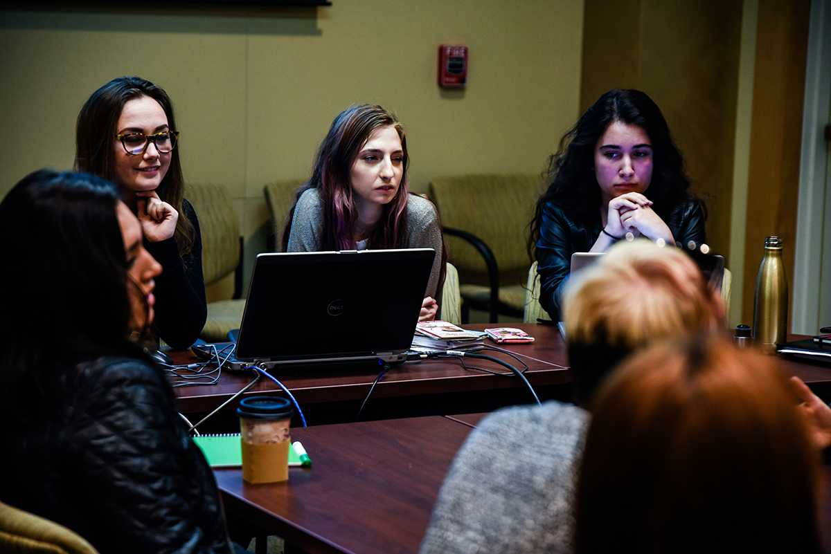 Hannah Cagle (center) leads one of the Feminists United club meetings, held every Wednesday at 7 p.m. in the Bertolini Center for Student Leadership.