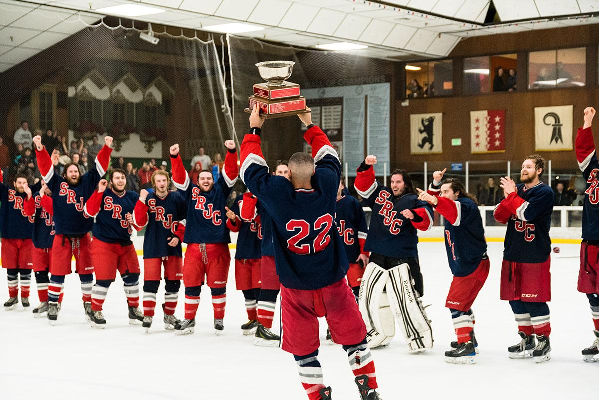 SRJC hockey captain Josiah Nikkel raises the Pacific Collegiate Hockey Association championship cup to his cheering teammates. The Polar Bears hockey team beat UC Davis for their fourth straight division title win.