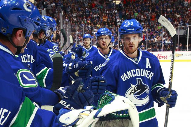 The+Sedin+twins%2C+Henrik+and+Daniel%2C+are+congratulated+by+teammates+after+scoring+a+goal.