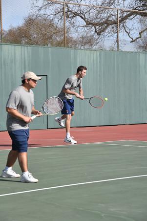 Bear Cubs men's tennis members get set during a practice match.