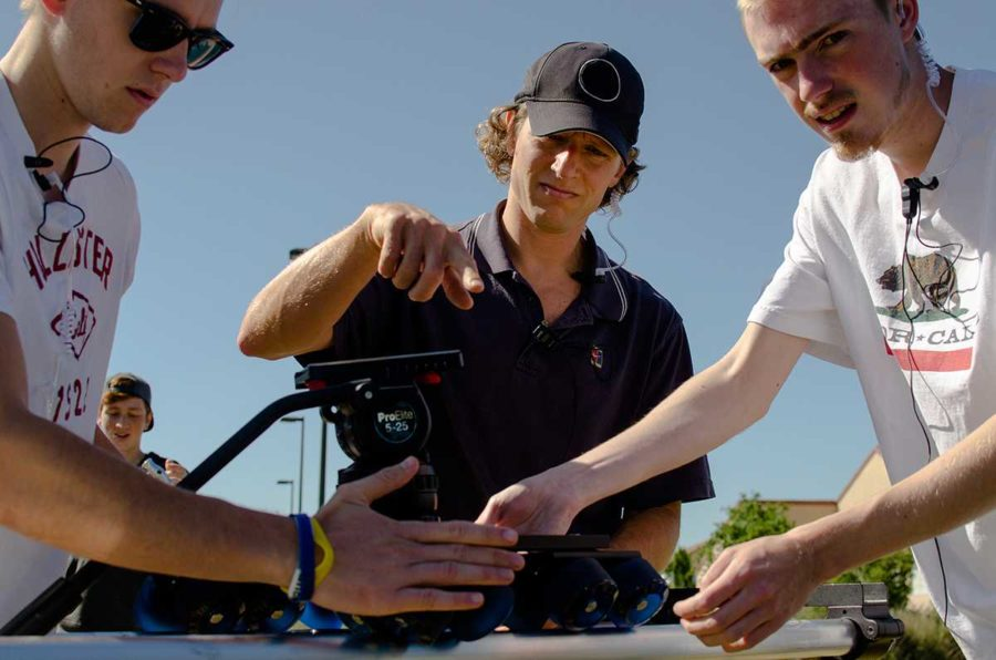 Brian+Antonson+works+and+instructs+students+during+an+onsite+shoot+for+his+introduction+to+filmmaking+class.