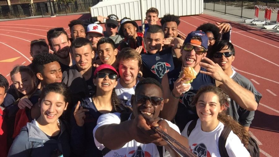 The Santa Rosa Junior College Bear Cubs track team uses a selfie stick to take a team photo on the field after one of  its practices.