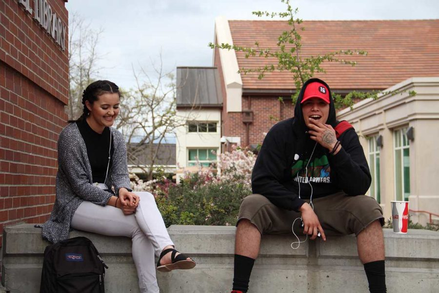 Spring+weather+makes+friends+and+SRJC+students+Chris+Hernandez+and+Sayra+Gomez+more+inclined+to+mingle+in+the+quad.%0A