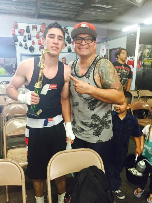 """Santa Rosa Junior College student Brian """"Hit-Man"""" Jimenez celebrates another win with his coach Hector. Jimenez balances work, school and a full time commitment to becoming a professional boxer and reaching his ultimate goal of making a name for himself in the super featherweight division."""