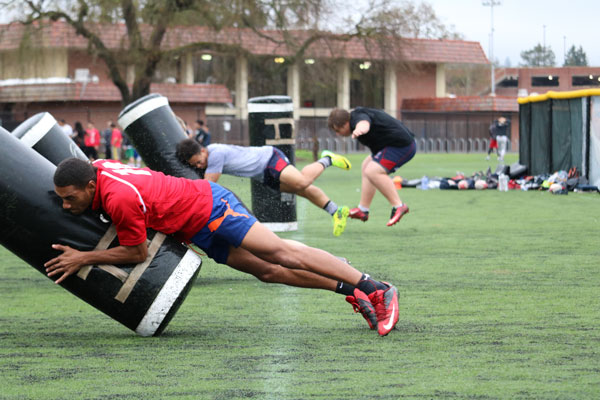 The Santa Rosa Junior College rugby club performs tackling drills during a practice March 3. The rugby club continues its hard work to prepare for games despite their low fan turnout.