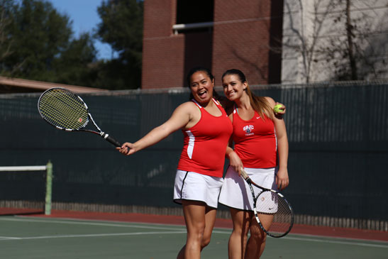 Right: Bear Cub tennis players Betsy Samonte and Coral Imnhoff celebrate their 8-0 victory Feb. 26 against American River College. SRJC women's is undefeated this season.
