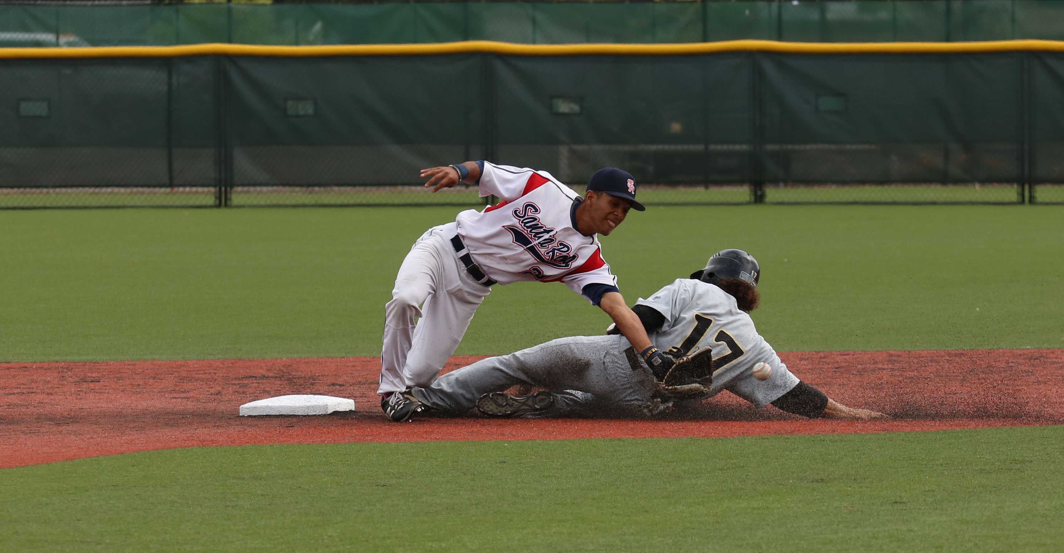 Santa Rosa Junior College second baseman Myles Andrews attempts to tag out a San Joaquin Delta runner trying to steal second base. SRJC captured its first conference championship since winning the  Big Valley Conference in 2005, on its way to winning the State Championship.