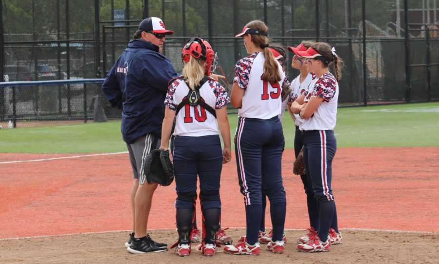SRJC+softball+head+coach+Phil+Wright+makes+a+visit+to+the+mound+to+discuss+the+team%E2%80%99s+strategy+for+the+next+batter+in+a+game+against+San+Joaquin+Delta+College+April+21+at+Marv+Mays+Field.+The+SRJC+softball+team+currently+has+a+7-11+record+in+conference+play+and+an+overall+record+of+18-18.+