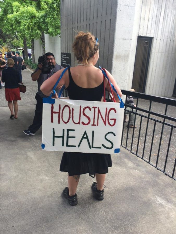 Rent control protestors sported signs in support of their cause.